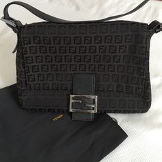 "FENDI - Black Handbag 100% Authentic - FENDI black handbag. Gently used FENDI purse.  Has iconic ""F"" print all over & black leather strap. 3rd picture shows date code for the purse. 4th picture shows a little wear on the bag. Comes with FENDI dust bag. ✨ NO TRADES/NO PAYPAL ✨. Price is negotiable & I'm always open to offers. Please submit an offer if interested . Measurements: 10 inches tall - 12 inches wide - 5 inches deep. FENDI Bags Shoulder Bags"