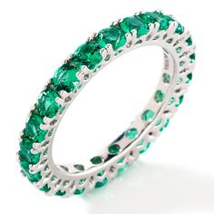 emerald band ring - this plus blue topaz for an anniversary ring (midgets birthstones). Yes, please!