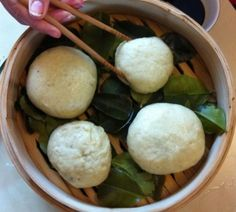 Amazing pork buns in a bamboo steamer