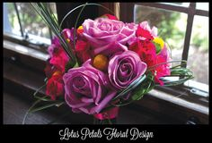 Contrasting pink bridal bouquet with billy balls and bear grass!
