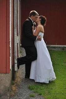 The magic happens through the glass: Hardenbrook, Bryan and Brianna Bride and groom sneaking away for a kiss.