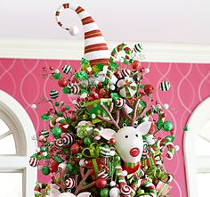 Pier 1 Elf Hat Tree Topper and assorted ornaments are bursting with personality