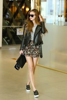 Black leather jacket over grey t-shirt + black floral print shorts + black sneakers