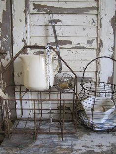 Old white pitcher, baskets