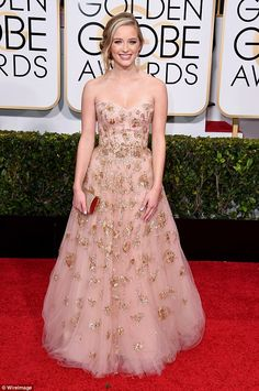 Pretty in pink: The blonde beauty looked stunning in a flowing pink gown with gold embellishments by Lorena Sarbu as she arrived at the 2015 Golden Globe Awards