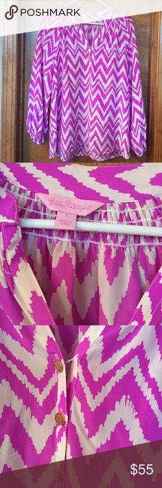 Lilly Pulitzer Silk Elsa Top Color is tropical pink. Pattern is Get your Chev On. Top button is loose but still attached. Otherwise, in great condition! Lilly Pulitzer Tops
