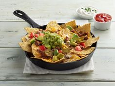 An Easy crowd pleasing meal or snack for your hungry football fans. Great for leftover steak or chicken! Just add WHOLLY® GUACAMOLE! #footballfood #nachos #leftover #leftovers #avocado #guacamole #quick
