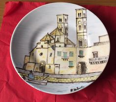 Santa Claus in Molfetta (Bari, Puglia, Italy) has a different tradition: children found dishes full of chocolate and sweets under the Christmas Tree the 7th of December. This is the dish I painted with the typical Duomo of Saint Corrado. The peculiarity: it has two towers.
