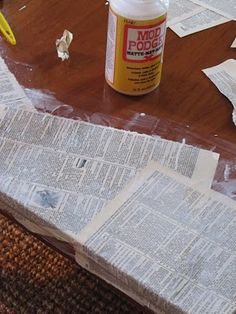 Interesting redo of coffee table using Mod Podge and pages from an old dictionary....I might want to do this with pages from an old bible!  Maybe....