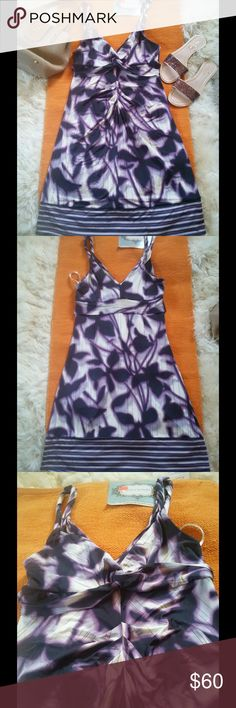 "BCBG MAXAZRIA  stretch purple dress I'm selling a Bcbgmaxazria slinky stretch purple abstract leaf print twist dress, stretch dress with a purple, black and off white abstract leaf print. Twist at bust, twisted straps, band below bust, ruched  on center front.striped band at hem. Size M.  fabric 93% rayon 7% spandex 36"" length from shoulder to hem. Excellent condition no flaws BCBGMaxAzria Dresses Midi"
