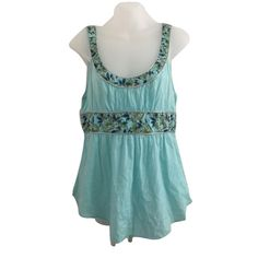 Free People Sz 8 Teal Fit & Flare Sleeveless Top Free People Sz 8 Teal Fit & Flare Sleeveless Top.  Size 8, Floral, Metallic silver outline, sleeveless, back tie, bust 36-38pre owned good condition no rips or stains. Free People Tops
