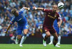 Fernando Torres and Pablo Zabaletta battle it out as Chelsea and Manchester city clash in 2012 at Villa Park due to Wembley hosting the football in the London Olympic Games www.betfred.com/football Fa Community Shield, Chelsea, London Olympic Games, Villa Park, Bridge, Manchester City, Olympics, Soccer, Football