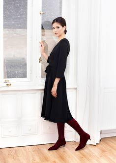 A fluid, feminine black dress suited to many occasions. The flattering silhouette features a beautiful V-neckline, a wide waistband with gentle folds above and a flared skirt. The stretch fabric ensures a comfortable fit. Black Suit Dress, Dress Suits, Dresses, Fall Capsule, Taylor Dress, Flared Skirt, Stretch Fabric, High Neck Dress, Feminine