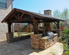 Overhead Structure/Grilling Station/Fireplace - traditional - patio - dallas - Weisz Selection Lawn & Landscape, Inc.