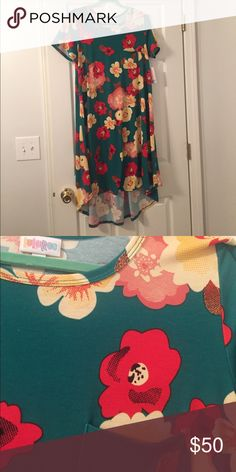 Floral Carly Brand new! This was my unicorn, but it's just too big. Green background with red, pink, and yellow/cream flowers. Perfect for warm weather! LuLaRoe Dresses