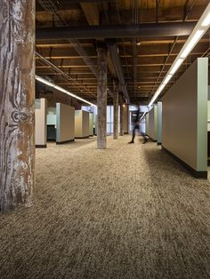 Great juxtaposition of rough textures with smooth clean lines. On the floor -- Ecliptic Point carpet from Mannington Commercial.