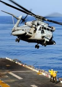 A CH-53E Sea Stallion helicopter assigned to Marine Medium Helicopter Squadron 262 takes off from the flight deck of the forward-deployed amphibious assault ship USS Essex (LHD 2)