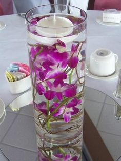 Centerpieces with Curly Willow and Dendrobium Orchids - 40  Creative Flower Arrangement Ideas, http://hative.com/creative-flower-arrangement-ideas/,
