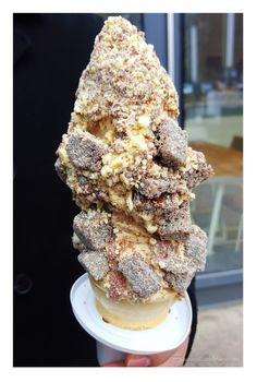 Sticky Toffee Pudding Soft-Serve Ice Cream - (caramel soft-serve drizzled with caramel sauce and topped with sticky toffee pudding and white chocolate and orange dust)