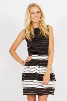 Women's Classic Black and White SHOW YOUR STRIPES DRESS by Sugarlips – BKLN Now y'all....This black and white beauty might just be the death of me! Just kidding...but really...This black and white Show Your Stripes Dress by Sugarlips is just PURE PERFECTION!! Can't get enough!! The A-line structure itself in a dress is always simple and classic but the black and white striped detail is just amazing! The dress is partially lined with an exposed zipper closure on the back.