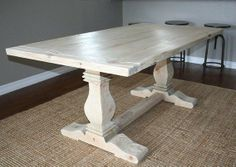 Custom reclaimed wood trestle table by carpenter Jeff Santini out of Oceanside, California.  Lovely repurposed barnwood with a whitewashed finish for a classic dining room.