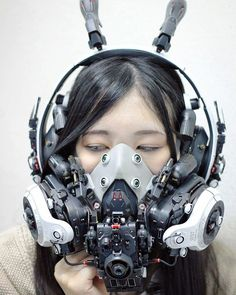 Modeler Hiroto Ikeuchi combines plastic model pieces and working electronics he modifies to create surreal works of art with awe-inspiring detail. His newest creation is this white face mask that features a futuristic cyberpunk design for a one-of-a-kind cyborg-like look when you wear it, and it combines earmuffs and a respirator with painstakingly crafted details for a functional work of art that's perfect for cosplay (or the apocalypse!).