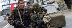 Pro-Russian rebels at a checkpoint near the airport in Donetsk, eastern Ukraine on Sept. 10 (Marko Djurica/Reuters)