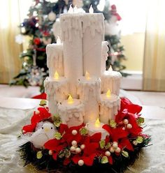 Velas decorativas de natal com rolos de papel