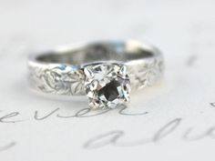 White topaz is a very affordable alternative to diamonds. Engagement ring  recycled silver by peacesofindigo