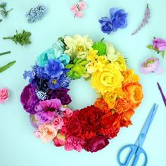 Learn how to make this stunning rainbow wreath out of faux flowers.
