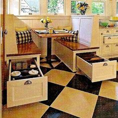 Space Saving Booth Style Kitchen.  Like the storage.