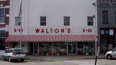 """the first Walmart opens in 1962 as Walton's 5 and Dime. The original """"Wal-Mart"""" store in Bentonville, AR. Its interior has since been transformed into a Walmart Museum."""