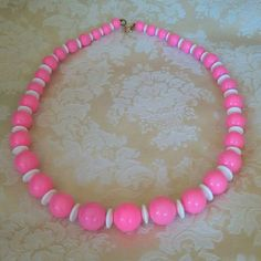 Check out this item in my Etsy shop https://www.etsy.com/listing/263914829/vintage-chunky-bubblegum-pink-and-white
