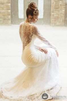 This dress is romantic, daring and gorgeous all at the same time. The lace detail is breathtaking.AND the hair! More