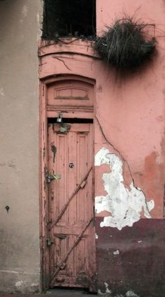 pink door on Bourbon Street, French Quarter by estelle