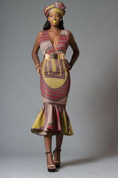 45 Fashionable African Dresses Discover the hottest ankara African dresses you need this season. Everything from peplum, bubble sleeves, and flare to mixed African print. This season's hottest styles & where to get them are in one convenient post. African Dresses For Women, African Print Dresses, African Attire, African Wear, African Women, African Prints, African Clothes, African Outfits, African Style
