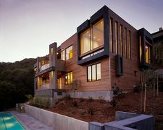Designed by House + House Architects, this 3,500 square foot two-storey residence is perched on a southern slope in Marin County, California.