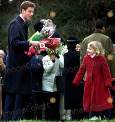 ALPHA 046326 25/12/01 Prince William (L) jokes with Katherin Bennett, 6, (R) as she gives him flowers and gifts outside Sandringham at the end of the Sunday church service at St Mary Magdalene Church, Norfolk. -ROYALS CHRISTMAS DAY SERVICE AT SANDRINGHAM CHURCH.