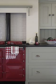 Country kitchen w/ red AGA cooker; cabinets by Landmark Country kitchen w/ red AGA cooker; cabinets by Landmark Aga Kitchen, Unfitted Kitchen, Kitchen Paint, Home Decor Kitchen, Kitchen Interior, Kitchen Design, Kitchen Cabinets, Kitchen Grey, Kitchen Modern
