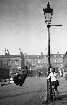 London children improvise a rope swing. Isn't childhood beautiful, every child deserves this.