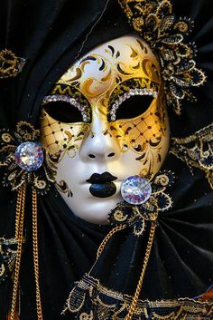 Master of disguise: a Venetian mask NIce detail, lots of cool colours, a pontential canidate for project