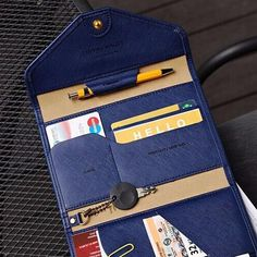 To all stylish and savvy travelers, this is for you! This wallet will holdyour passport, ID cards, keyswhile you fly to your next destination. Contains: Zipper pocket Receipt pocket Passport pocket Boarding pass holder Key holder Pen holder Card holder Material:Faux leatherSize:6.5 x 4.5 in (folded) Delivery:Please allow 5 to 21 days for shipping