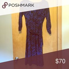 Long sleeved dress Dress like Loreali Gilmore in this long sleeved, bright blue and black faux wrap dress. Touching on sleeves and neck line are incredibly flattering. Gorgeous on, but I have had no Friday night dinners to wear it to. Size 8. Jones New York Dresses Long Sleeve
