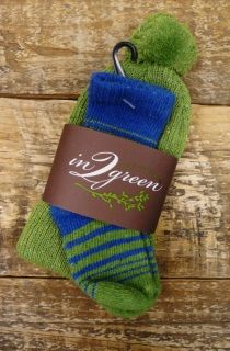 In2Green is an eco luxury company from Hudson, NY that uses recycled cotton scraps from textile mills from the US and Central America. The textile scraps are re-fiberized into spinable cotton that does not need to be de-dyed.   Baby Sets come in one size and include one pair of socks and one hat.  The material is 85% regenerated cotton, 10% nylon and 5% elastic.   Machine wash in cold water.