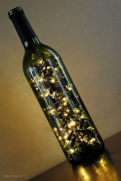 Wine Bottle Lights. Dark wine bottle, remove the labels, drill a hole in the side, insert white lights (with dark strand)