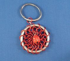 Chainmaille dreamcatcher keychain with a cute little lady bug.