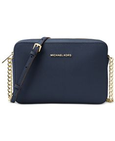 Sophisticated yet street-chic, the Jet Set large crossbody bag from Michael Michael Kors features luxe textured leather with gilded hardware, an adjustable strap and lots of storage for on the go. Cute Handbags, Cheap Handbags, Luxury Handbags, Purses And Handbags, Wholesale Handbags, Prada Handbags, Michael Kors Tote, Handbags Michael Kors, Michael Kors Jet Set