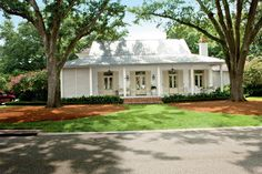 First of all I'm dying to paint or whitewash my brick house. I think the look of a white house is so crisp and clean. This house designed by Mia James in Baton Rouge is right up there as a to… Exterior Paint Colors For House, Paint Colors For Home, Paint Colours, Cottage Exterior Colors, Style Cottage, Farmhouse Style, French Cottage, Farmhouse Front, Farmhouse Shutters
