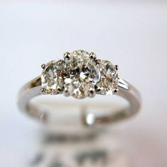 LOVE this ring. Bling size great! However, this ring reminds me too much of my mother's ring... thus its a no go.