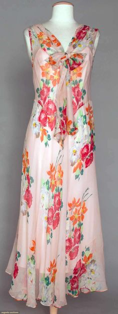 """TWO FLORAL CHIFFON DAY DRESSES, 1930s Go Back Lot: 349 November 2, 2011 NYC New York City Identical bias cut construction, CF ties, scallop edging on arm holes & back V-neck, B 34"""", W 34"""", L 50.5"""": 1 pink w/ red, orange & green; 1 white w/ blue, pink & light green; very good-excellent. Brooklyn Museum"""